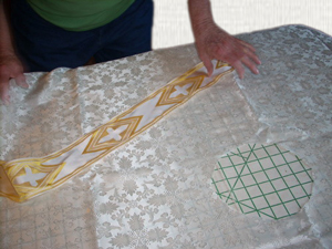 Applying the banding to a chasuble